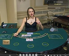 A live dealer setting up a Hold'em game.