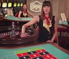 A 777 live casino dealer at the roulette table
