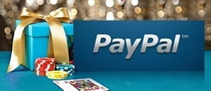 The PayPal logo next to a gift, playing cards and chips at a casino.