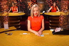 The cards of the Baccarat Squeeze live table game by Evolution Gaming at Greenplay.