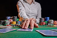 A croupier dealing cards.