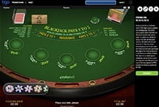 An in-game example from Premium Blackjack showing the table, chips, cards, and game details.
