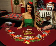 A dealer at a blackjack table at Casino.com.