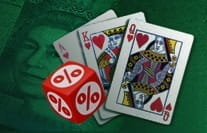A Casino Poker payouts image showing playing cards and a dice with a percentage symbol on it.