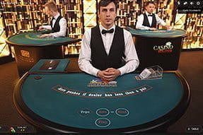 A live dealer at the Casumo poker table.