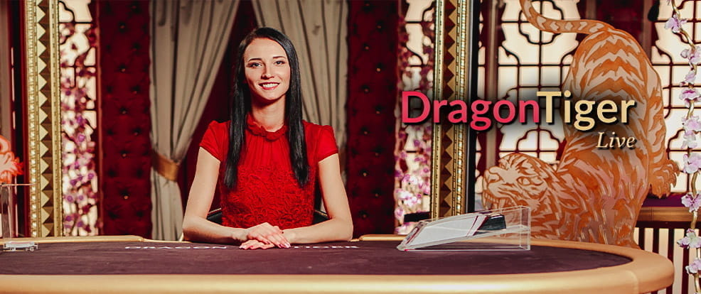 A dealer sitting behind a table for Dragon Tiger at a live casino