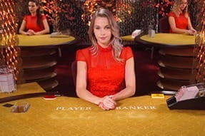 A live dealer hosts a game of live baccarat at Dunder.