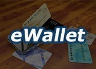 A darkened image of payment cards with the title eWallet.