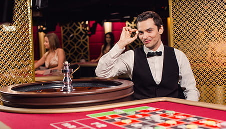 A live casino dealer ready to host a game at an online operator