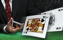 A cards player flicking his cards