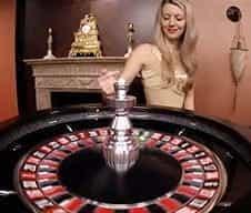 A LeoVegas live dealer at a roulette wheel.