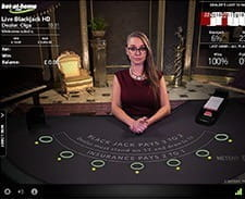 Image of a live dealer setting up a blackjack game.