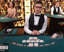 Image of a live casino poker game at Betsafe casino