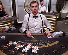 Image of a live dealer setting up a blackjack game at bwin casino