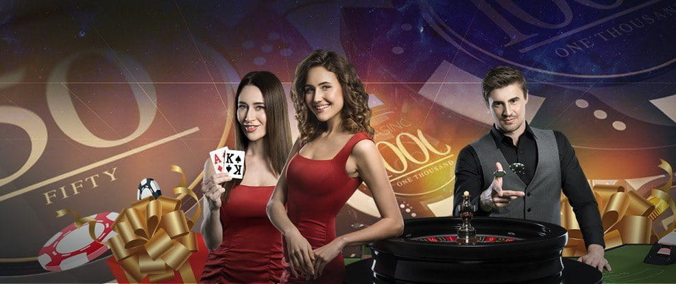 Live casino dealers at a roulette table.