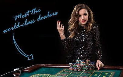 Image of a live casino dealer at a green roulette table, holding a casino chip, with superimposed text reading:'Meet the world-class dealers'.