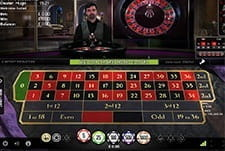 The live roulette wheel is poised for a rotation at Slotty Vegas
