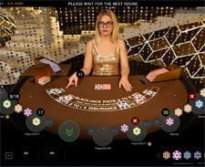 A live dealer dealing a blackjack game.
