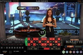 A live dealer at Mansion Casino hosting the Age of Gods Roulette game.