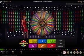 A live dealer at Mansion Casino hosting Spin A Win.