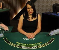 A live croupier at Mansion Casino.