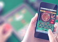 An QR code and image for mobile casino gaming.