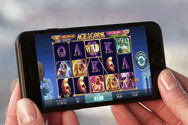 Image showing a smart phone with an online casino on the screen