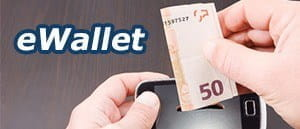 An image of money being put into a phone, with the title eWallet.