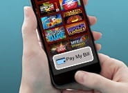 An image showing a casino client paying by mobile.