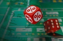A craps payouts image showing dice with percentage signs on them.