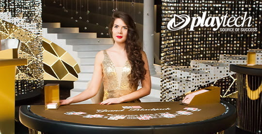 A live dealer from Playtech wears gold formal attire and smiles politely.