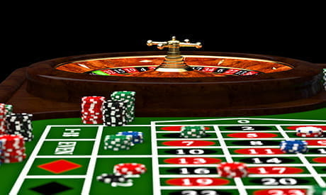 A roulette wheel, table and casino chips in an automated game.