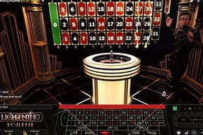 A live dealer at Roxy Palace hosting the Lightning Roulette game.