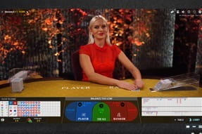 A live dealer hosts a game of live baccarat at SuperLenny.
