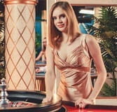 The embodiment of a classy casino live dealer, Sonja has a taste for baccarat.
