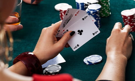 A player's hand holding three cards.