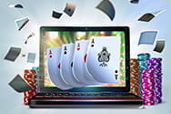 A laptop with playing cards.