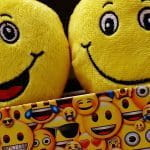 An image of two Emoji cushions in an emoji-themed box.