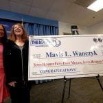 Mavis Wanczyk with her winning lottery cheque