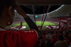 Fans in the stadium at a football match
