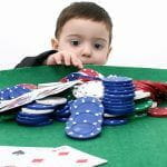 A child with casino chips.