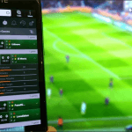 A sports betting image showing a player placing a bet at a football match.