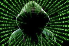 A masked figure surrounded by binary code signifying fraud detection.