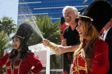 Branson celebrates with champagne at the announcement of the acquisition in Las Vegas.