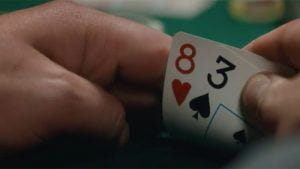 Close up of a poker players cards.