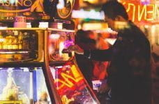 A man using a slot machine.