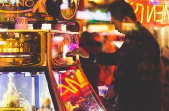 A man using a slot machine.