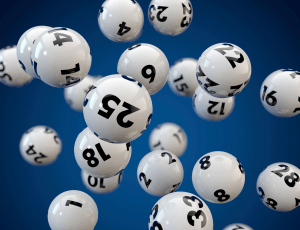 Numbered lottery balls hang in the air.