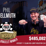 The poker champion Phil Hellmuth holds up his 15th gold bracelet.