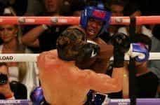 YouTuber KSI hits Logan Paul in the head.